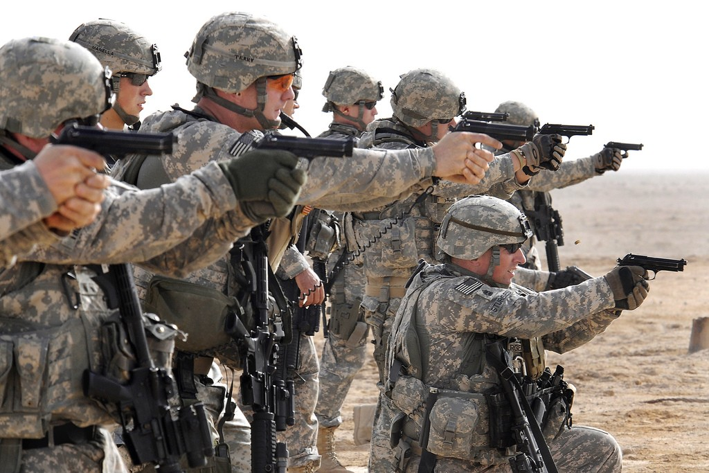 U.S. Soldiers participate in tactical range training.  Photo  by The US Army/  CC BY-NC-ND 2.0