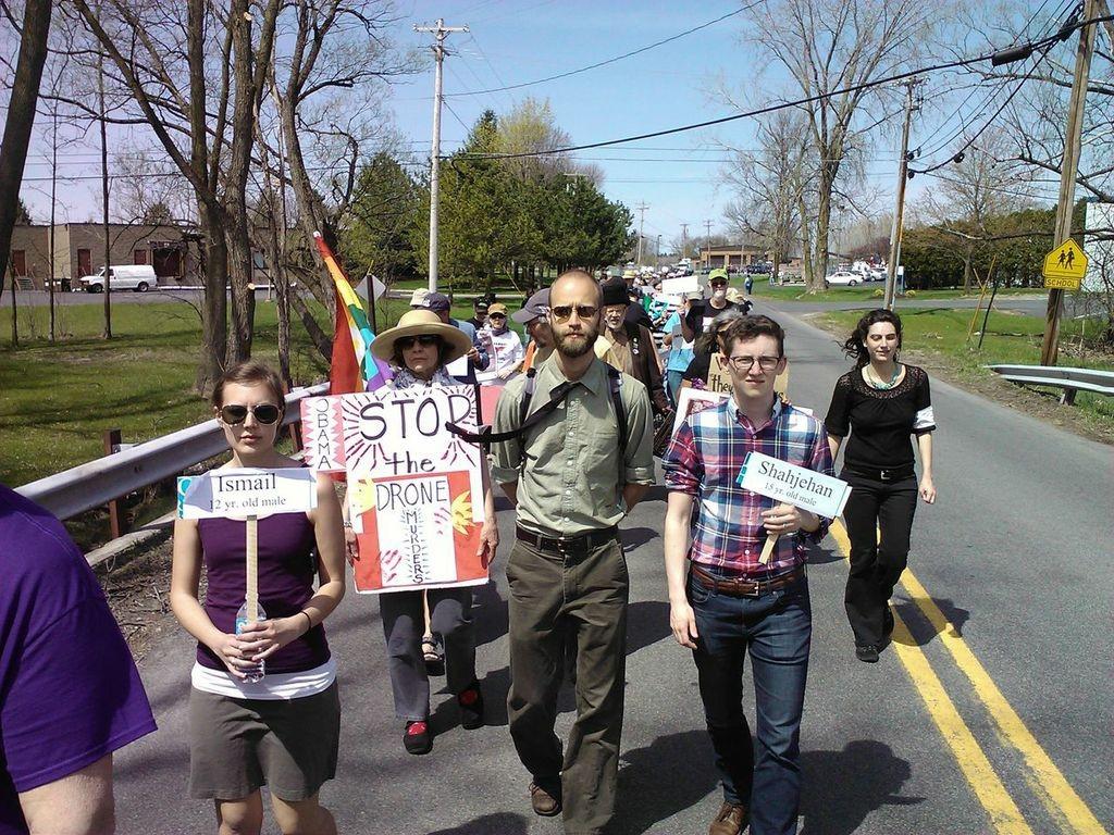 Protesters walk toward Hancock Air Base