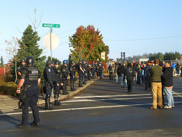 protesters and police outside gates during anti-war protest