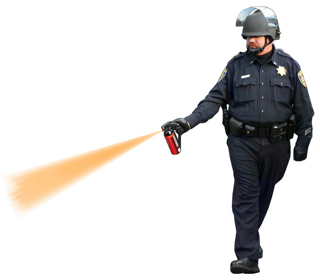 stylized photo of UC Davis cop pepper spraying