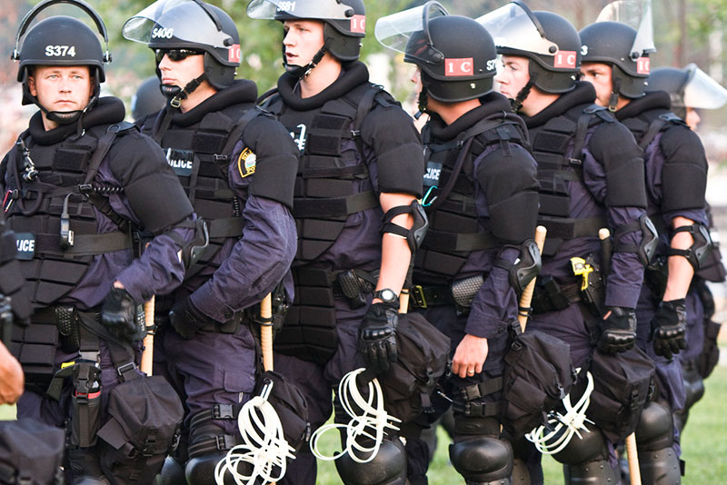 Law enforcement officers lined up in riot gear during the 2008 Republican National Convention.