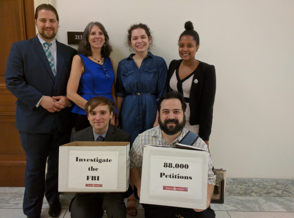 six people with boxes of petitions to deliver
