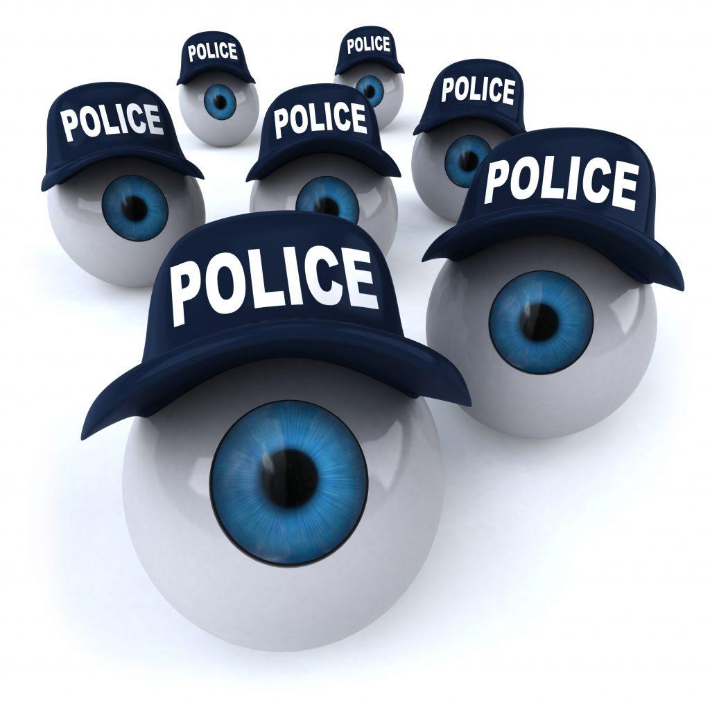 several eyeballs wearing police hats roll toward you