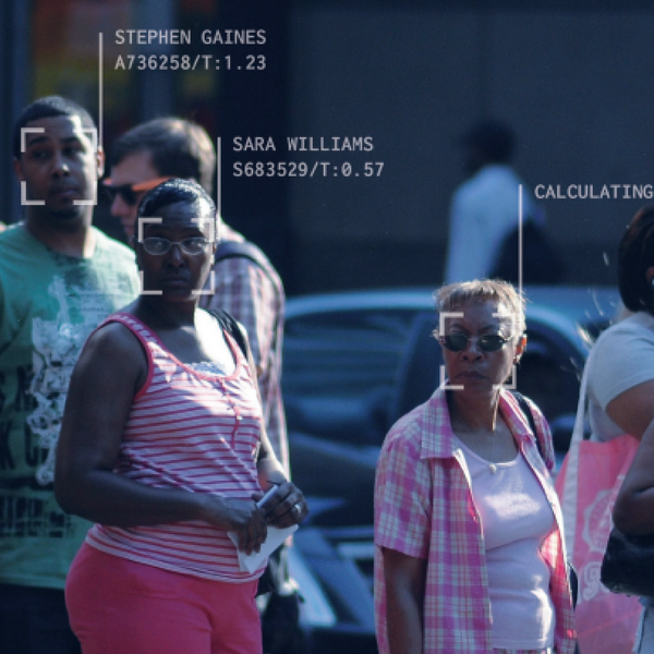 people on the street getting caught by face recognition camera