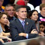 Michael Flynn scowls at a Trump rally