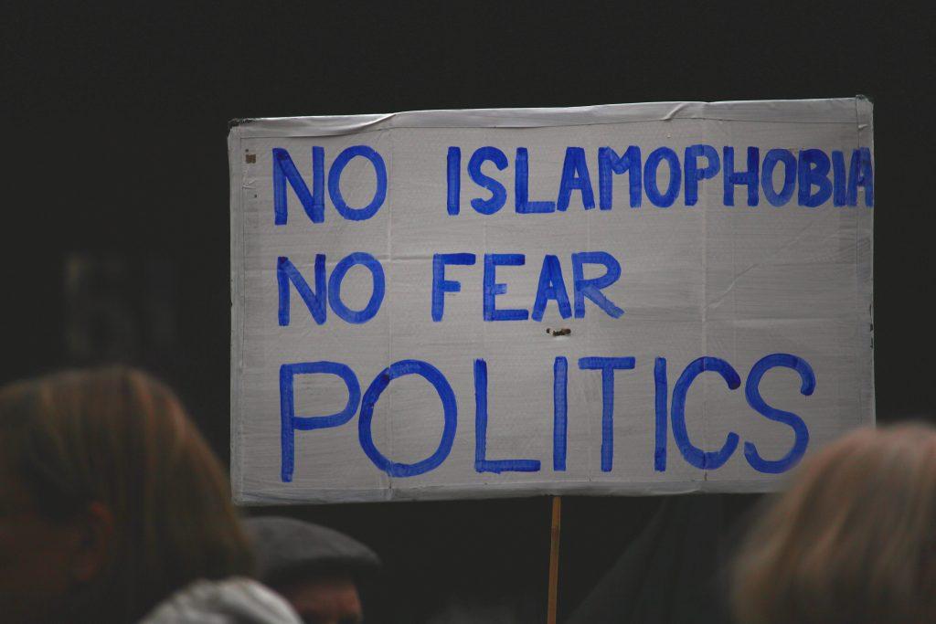 hand painted sign says no islamophobia no fear politics
