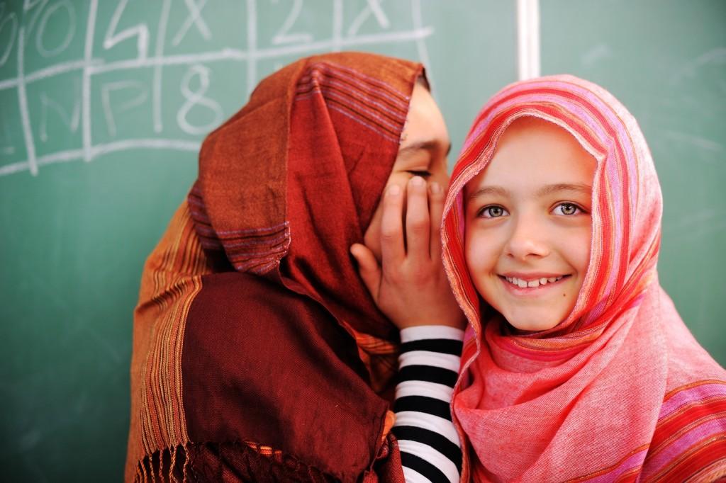 Cute lovely Muslim school children at classroom having education activities