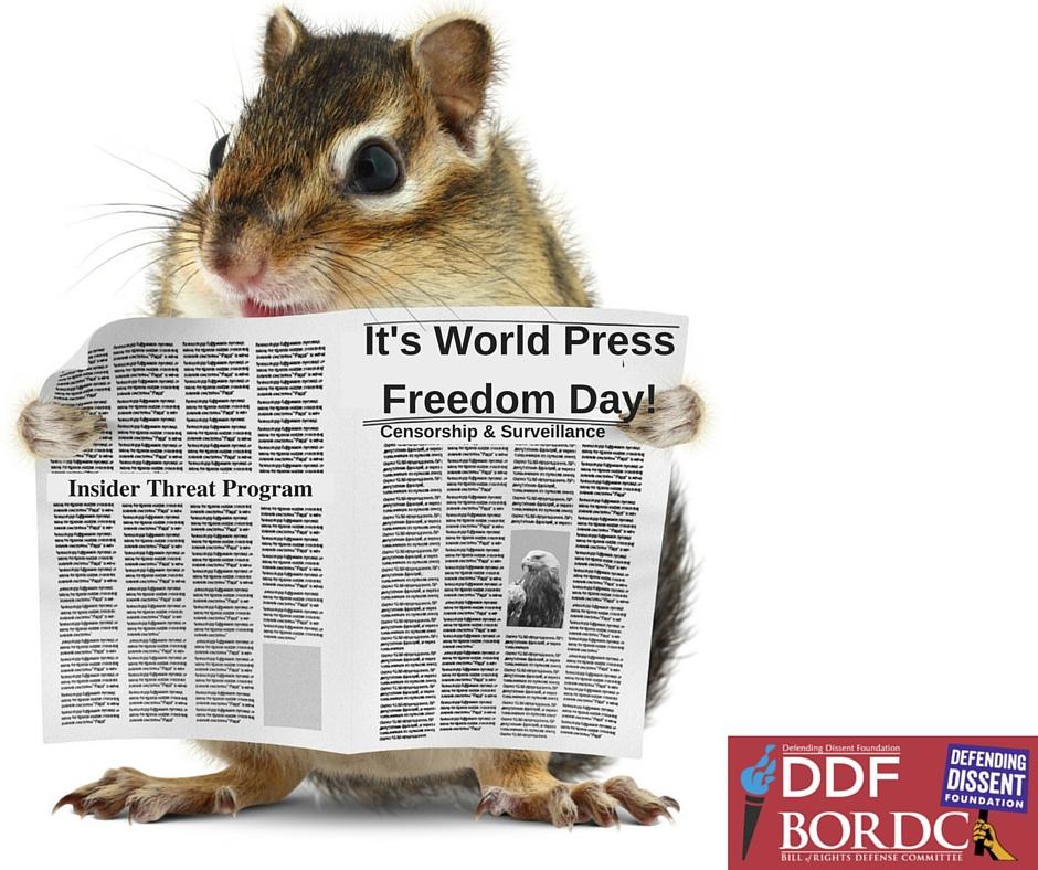 a chipmunk reads a newspaper celebrating world press freedom day